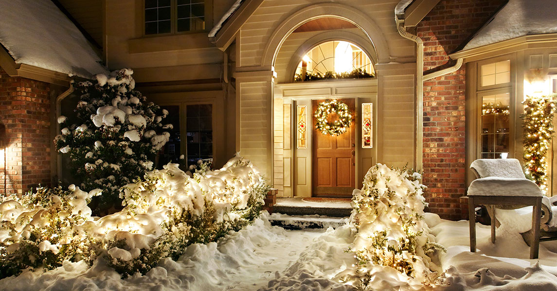 stock-photo-outside-christmas-lights-line-path-to-a-front-door-on-a-snowy-evening-78798733