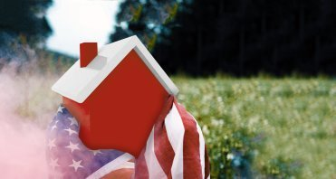 House wrapped in flag